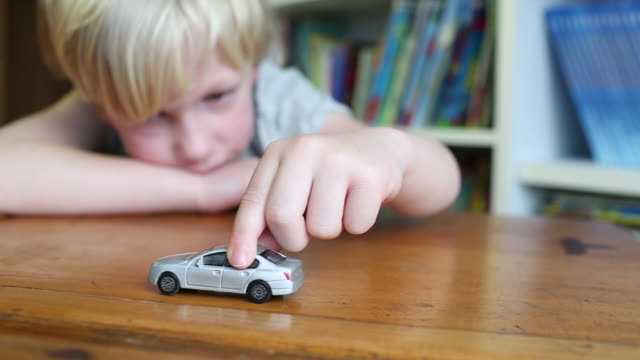 child playing with a toy car - boys stock videos & royalty-free footage