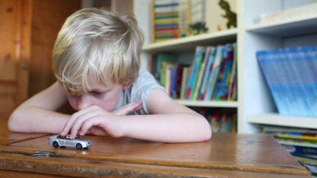 child playing with a toy car - spielzeug stock-videos und b-roll-filmmaterial