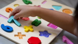 Child playing with Alphabet Letters and number.