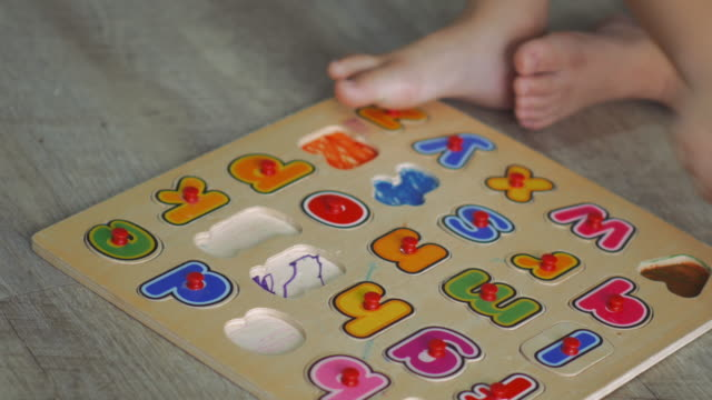 Child playing with Alphabet Letters