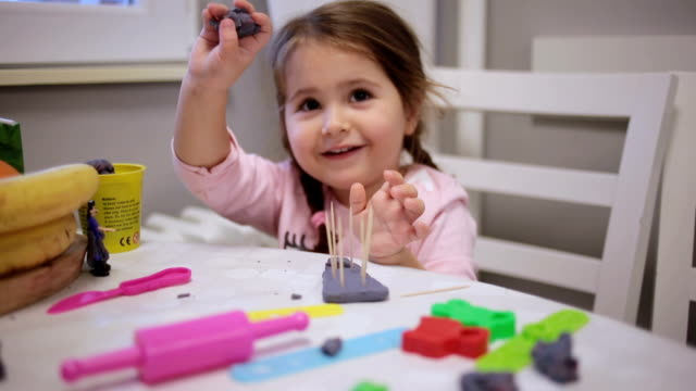 child playing with child's clay - table knife stock videos & royalty-free footage