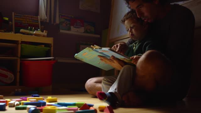 vídeos y material grabado en eventos de stock de a child playing with his toys - de origen español o portugués