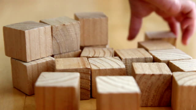 child playing with wooden blocks (full hd) - toy block stock videos and b-roll footage