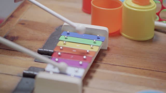 Child playing xylophone at home