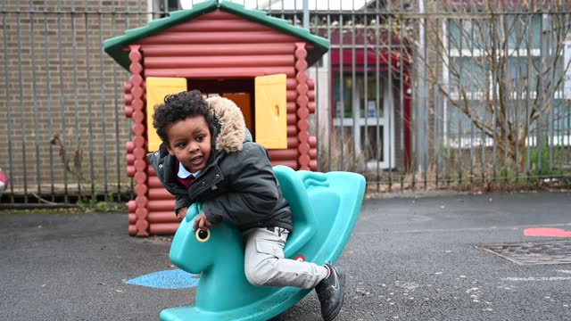 child plays outdoors at glan-yr-afon primary school on march 3, 2021 in cardiff, wales. children aged three to seven began a phased return to school... - playing stock videos & royalty-free footage