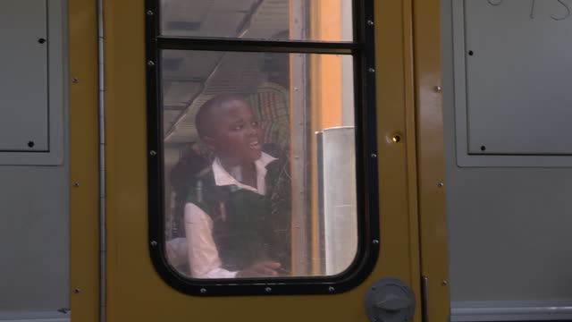 child points out of a train, south africa - reportage stock videos & royalty-free footage