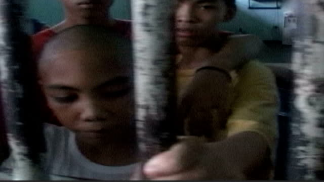 child prisoners kept in appalling conditions tx same boy prisoner filmed in a previous prison - philippines stock videos & royalty-free footage
