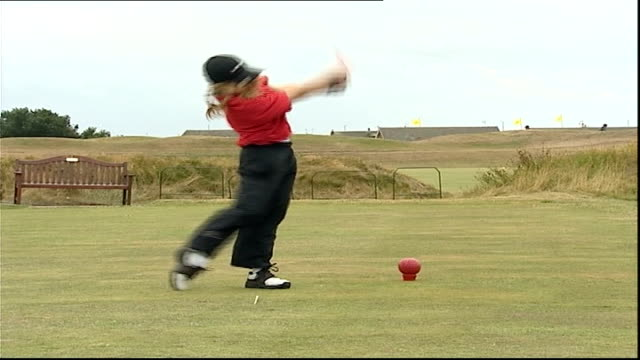 lancashire lythamstanne's ext charley hull drives off from tee on windy golf course charley hull walks across tee charley hull playing shot out of... - ゴルフのティー点の映像素材/bロール
