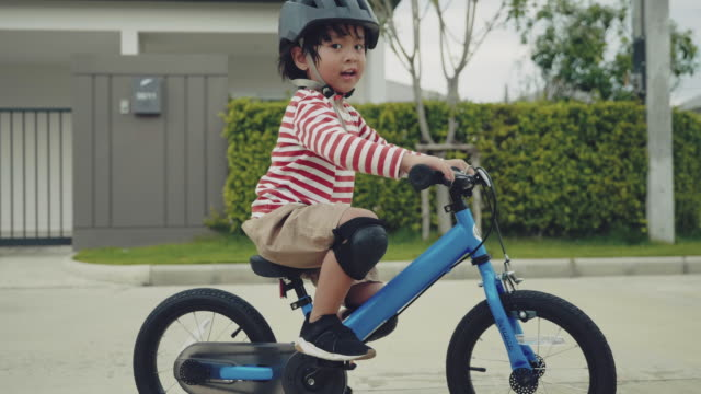 child racing on bicycle. - saddle stock videos & royalty-free footage