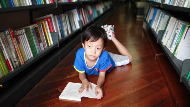 Child reading a book in the library