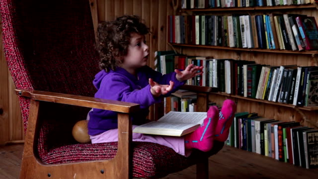 child reading book in the library - the alphabet stock videos & royalty-free footage