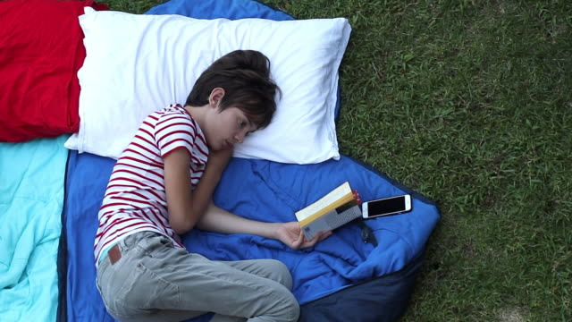 child reading, lying down - pillow stock videos and b-roll footage