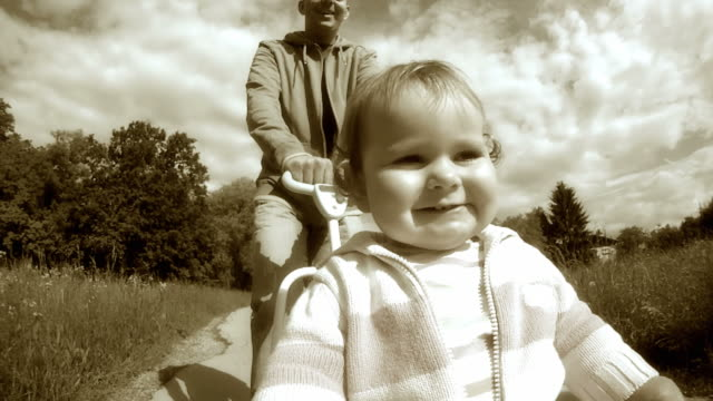 hd slow-motion: child riding a bike - sepia stock videos & royalty-free footage
