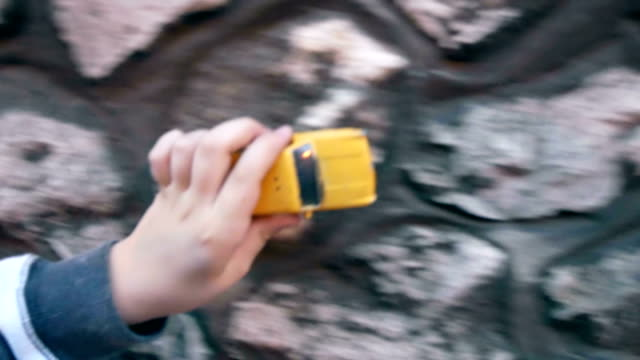child riding toy car - yellow taxi video stock e b–roll