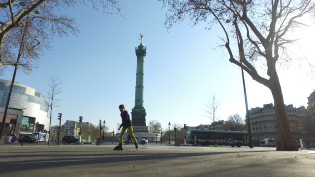 child rollerblades during the period of confinement in the street he has the right to one hour maximum of exit for a physical activity outside march... - bastille stock-videos und b-roll-filmmaterial