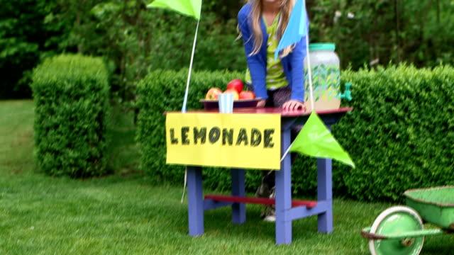 child selling lemonade in garden - western script stock videos & royalty-free footage