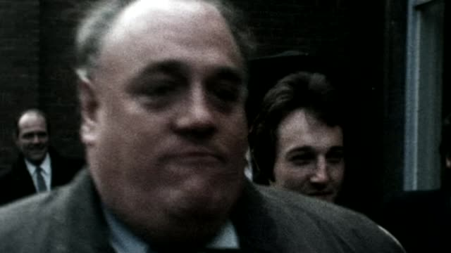 lead counsel resigns t28041445 england manchester ormskirk ext slow motion then liberal party mp cyril smith eating gingerbread man as along street... - mp stock-videos und b-roll-filmmaterial