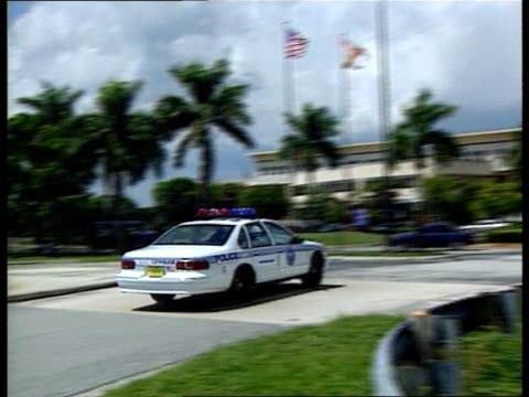 usa florida miami dade county sign 'metrodade police dept hq complex pan lr to buildings lms sergeant dee bailey another policeman towards past pan... - miami dade county stock videos and b-roll footage