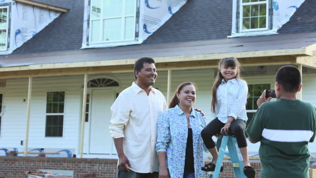 ws ds child shooting photograph of family in front of house under construction / eastville, virginia, united states - eastville stock videos and b-roll footage