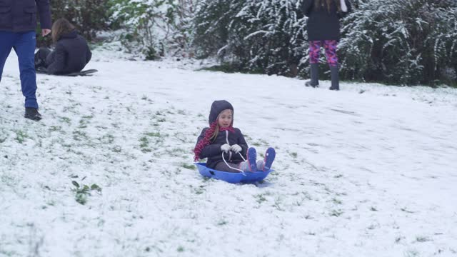 child sledges down a hill in north london on january 24, 2021 in london, united kingdom. parts of the country saw snow and icy conditions as arctic... - hill stock videos & royalty-free footage