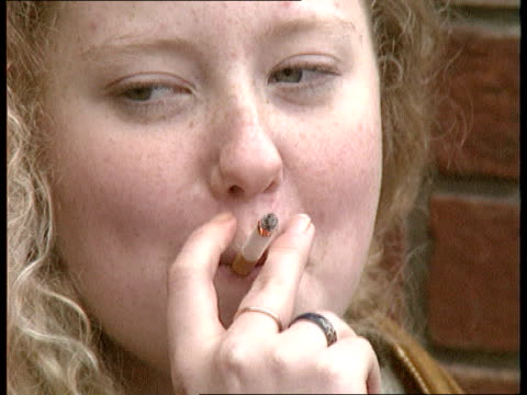 child smoking campaign fails int cs young girl smoking cs young girl smoking cs lit cigarette in hand of young person cs ditto cs ditto - cigarette stock videos & royalty-free footage