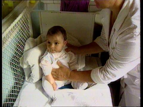 vídeos y material grabado en eventos de stock de child smuggling case orphanage tcms baby monica sitting in cot tx cs baby itn - orfanato