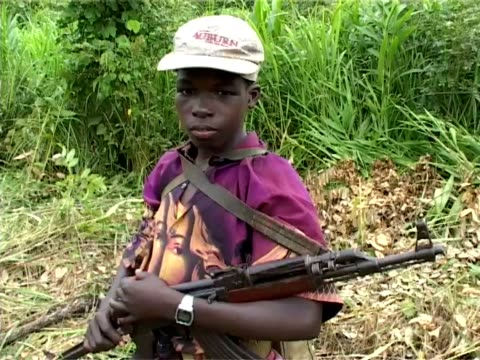 child soldiers of the lord's resistance army in the democratic republic of congo child soldiers lord's resistance army at garamba national park on... - bürgerkrieg stock-videos und b-roll-filmmaterial