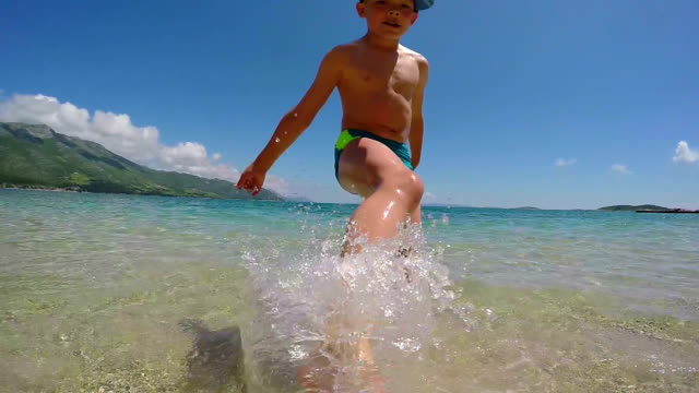 Child splashing in the sea