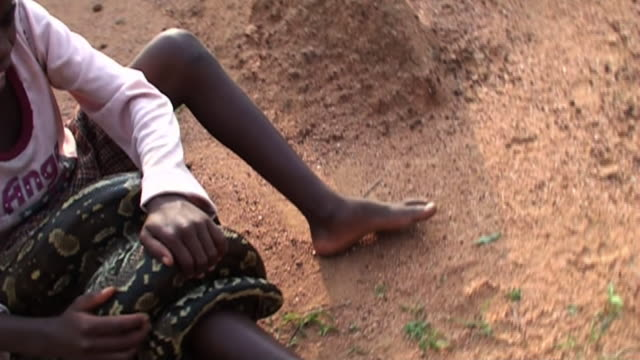 a child struggles to get an anaconda off his leg. - struggle stock videos & royalty-free footage