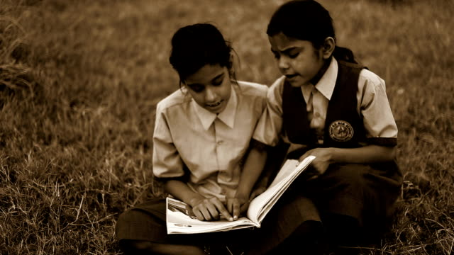 Child studying together outdoor in nature