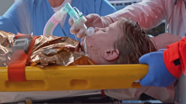 child suffering from hypothermia transferred to bed in the emergency room - hypothermia stock videos and b-roll footage