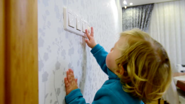 dolly: child switching off a light switch - light switch stock videos & royalty-free footage