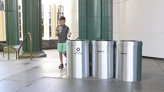child throws an object in a bin - straw stock videos & royalty-free footage