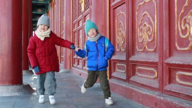 child tourist visit the forbidden city - chinese culture stock videos & royalty-free footage