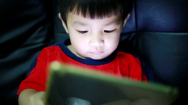 child using digital tablet alone at home - equipment stock videos & royalty-free footage
