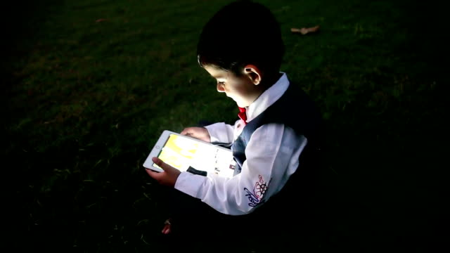 child using digital tablet at night - indian subcontinent ethnicity stock videos & royalty-free footage