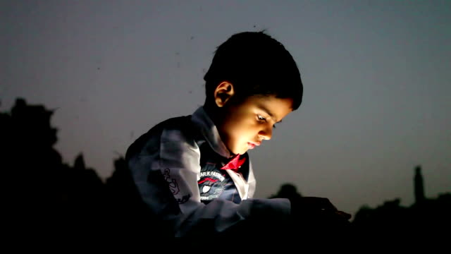 child using digital tablet at night - indian ethnicity stock videos & royalty-free footage