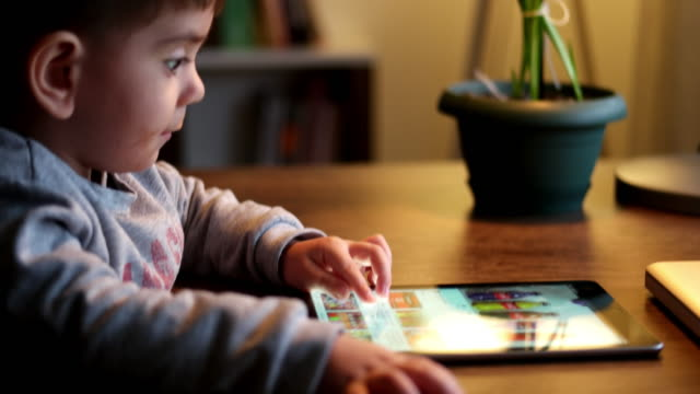 child using digital tablet - bedroom stock videos & royalty-free footage
