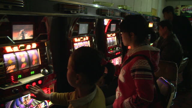 Child using gambling machine in North korea