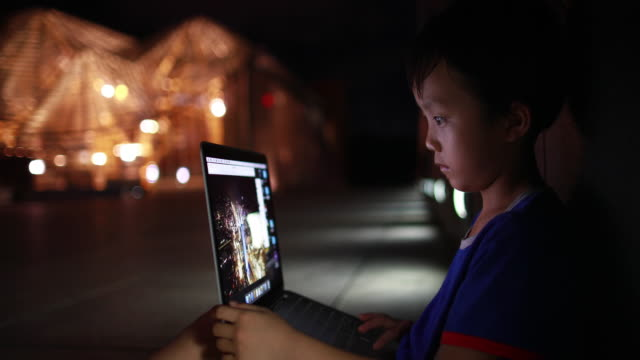 child using laptop in front of the shenzhen library - science and technology stock videos & royalty-free footage