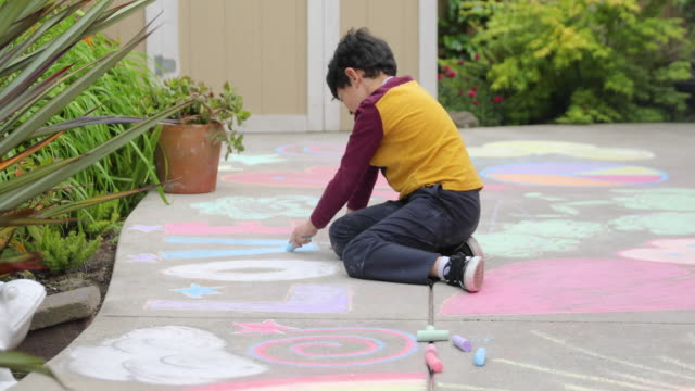 child using sidewalk chalk during stay at home order - chalk art equipment stock videos & royalty-free footage