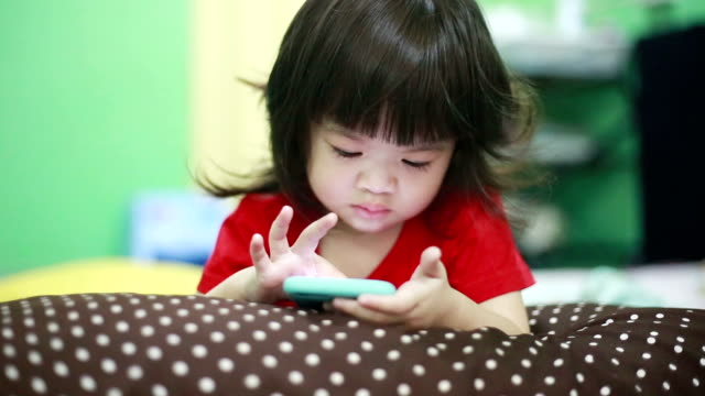 child using smart phone at home - digital native stock videos & royalty-free footage