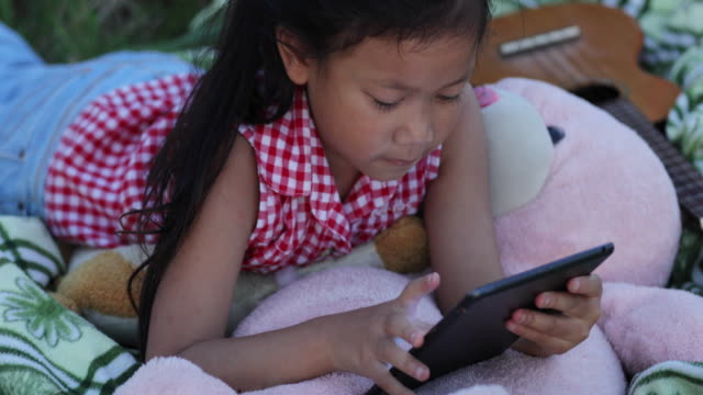 child using smartphone and tablet