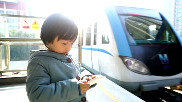 Child Waiting for Train on Platform