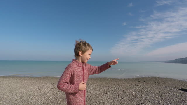 child walking by the sea