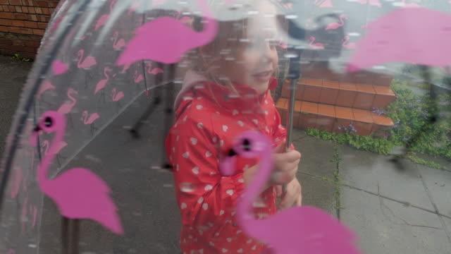 child walking in the rain - umbrella stock videos & royalty-free footage