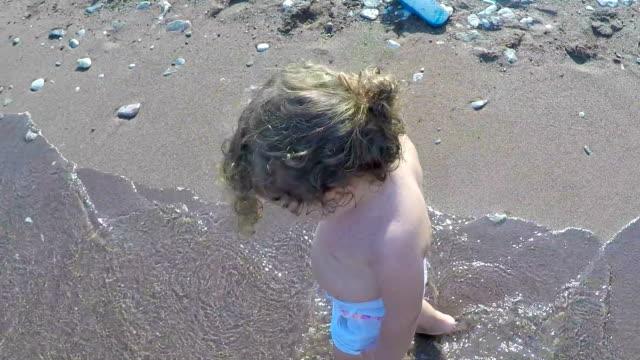 child walking on the beach - bikini stock videos and b-roll footage