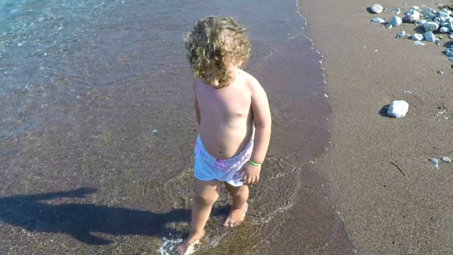 child walking on the beach - baby girls stock videos & royalty-free footage