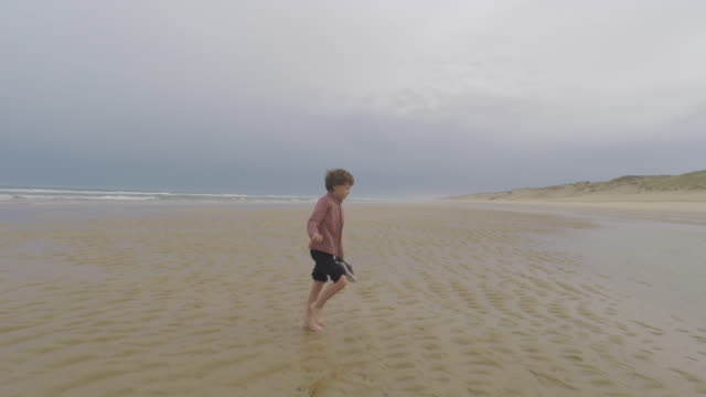 child walking on the beach - cap ferret stock videos & royalty-free footage