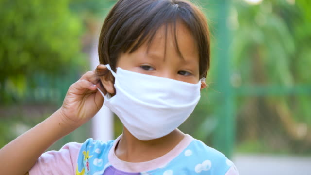 child wear face mask during coronavirus a mask protecting her from covid19. - indigenous north american culture stock videos & royalty-free footage
